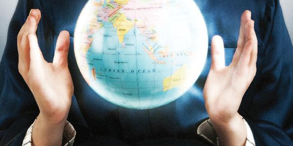 Globe levitating between hands