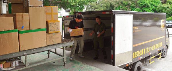 UPS truck receiving packages from loading dock in China