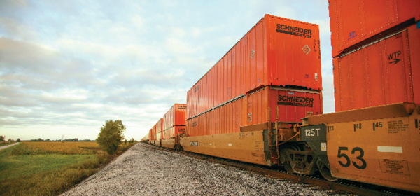 Intermodal shipping containers traveling by rail