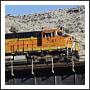 BNSF train on bridge rail
