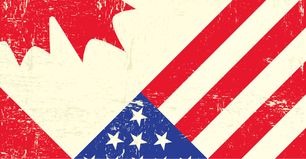 Canada and U.S. flags juxtaposed