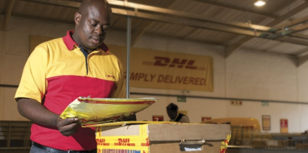 DHL worker sorting packages