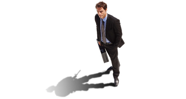 A businessman casts a shadow shaped like a soldier