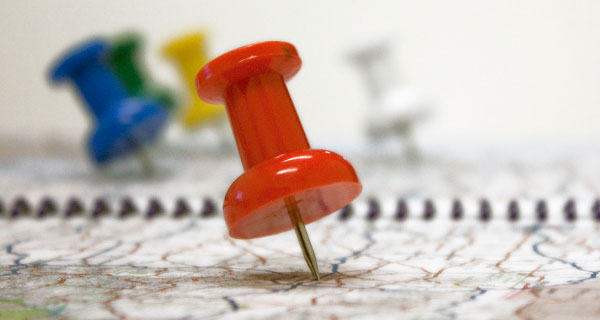 On the Road--A Logistics Travelogue--image of pushpins in a map