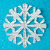 Snowflake cut out of paper